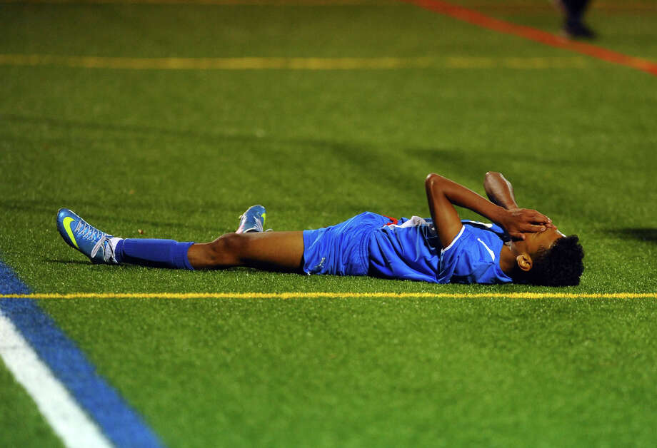 Bunnell's Joshua Martinez lays on the field reacting to missing a chance to get a goal, during boys soccer action against Stratford in Stratford, Conn. on Tuesday September 17, 2013. Photo: Christian Abraham / Connecticut Post