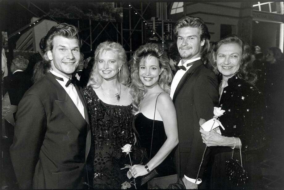 Former Houstonians, the Swayzes - Patrick Swayze and his wife, Lisa Niemi; Marcia and her husband, Don Swayze; Patsy Swayze - attend the 1987 Gourmet Gala. Photo: Steve Ueckert, Houston Chronicle / Houston Chronicle