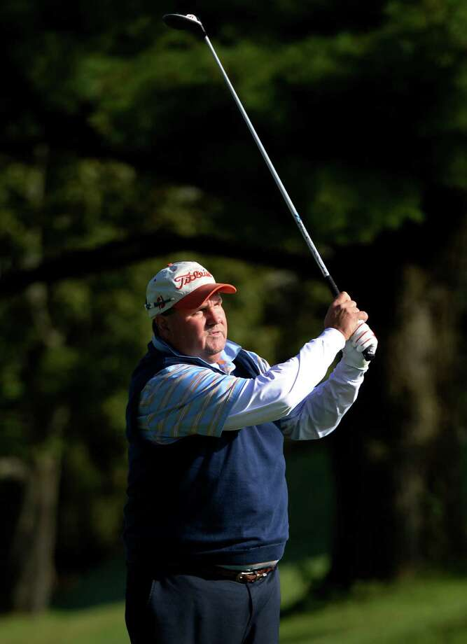 John Donovan representing the Schenectady Municipal Golf Course tees off in the New York State Seniors Tournament at the Normanside Country Club Tuesday morning Sept 17, 2013 in Delmar, N.Y.       (Skip Dickstein/Times Union) Photo: SKIP DICKSTEIN / 00023892A