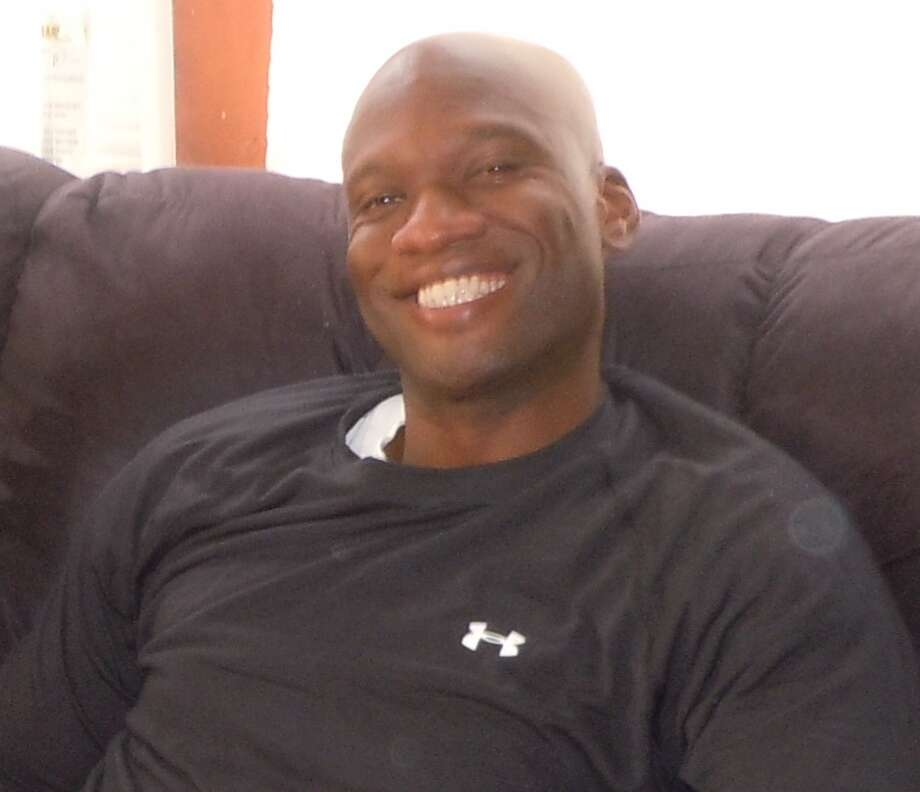 Aaron Alexis once worked near New York's World Trade Center, and friends say he assisted people injured during the Sept. 11 terror attacks. Photo: Photo Courtesy Kristin Suthamtew / Photo courtesy Kristin Suthamtew