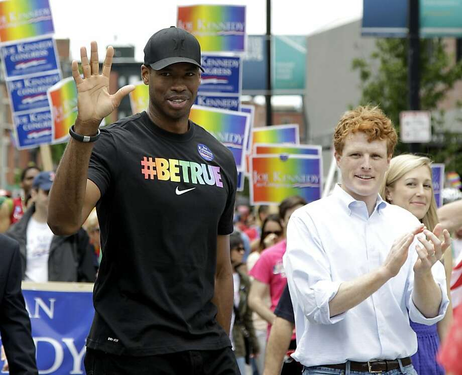 NBA veteran Jason Collins, left, the first active player in one of four major U.S. professional sports leagues to come out as gay, marches in Boston's gay pride parade alongside U.S. Rep. Joe Kennedy III, a college roommate, Saturday, June 8, 2013, in Boston. Collins said he realized he needed to go public when the Democratic congressman walked in Boston's gay pride parade last year and Collins decided he couldn't join him. (AP Photo/Mary Schwalm) Photo: Mary Schwalm, Associated Press