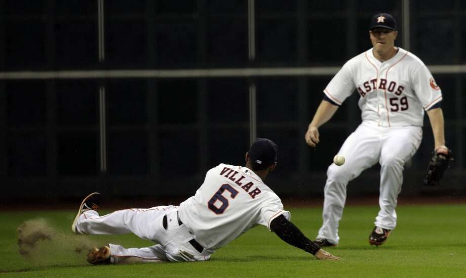 Astros shortstop Jonathan Villar is unable to make a play on defense against the Reds. Photo: Melissa Phillip, Houston Chronicle