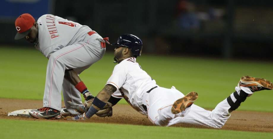 Astros shortstop Jose Villar can't make it to second base in time against the Reds. Photo: Melissa Phillip, Houston Chronicle