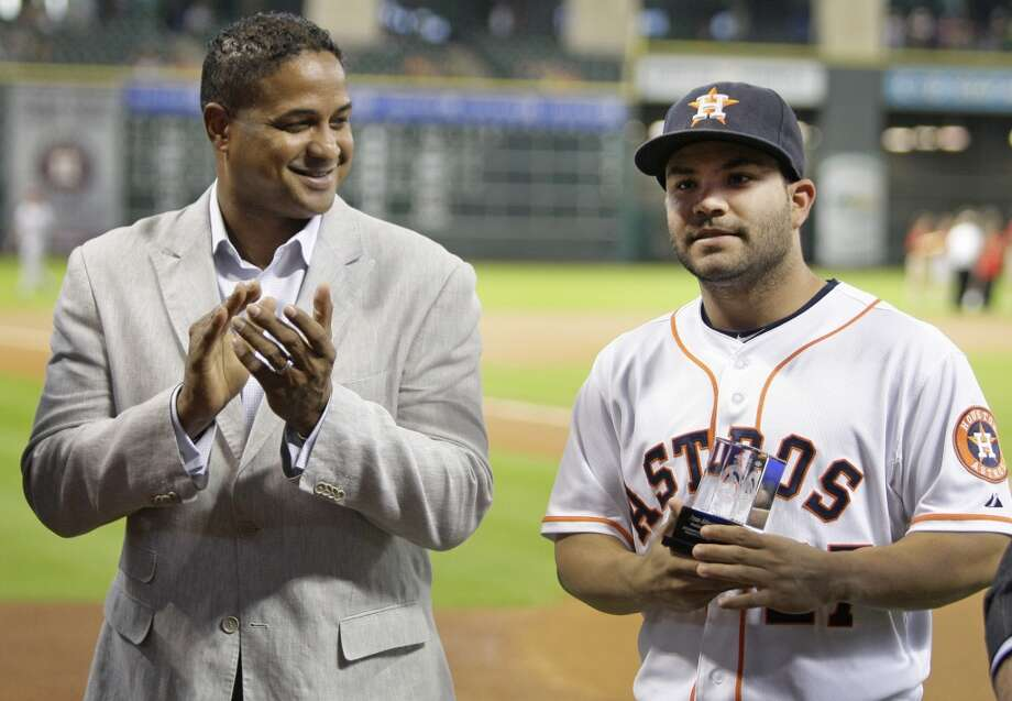 Roberto Clemente Jr., left, applauds Astros second baseman Jose Altuve after applauds him for being named as a 2013 nominee for Roberto Clemente Award. Photo: Melissa Phillip, Houston Chronicle