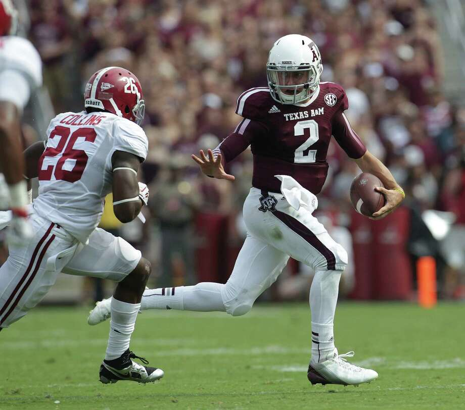 When Johnny Manziel scrambles, crazy things can happen, with the craziest from the Alabama game being a spectacular pass play in the second quarter that earned Edward Pope, right, well-deserved congratulations. Photo: Karen Warren, Staff / © 2013 Houston Chronicle