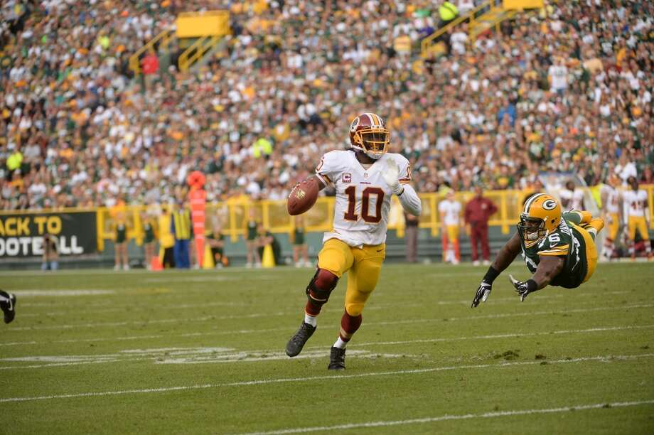 Robert Griffin III No. 2 overall pick Washington RedskinsOh, how different things might have looked if not for the knee injury Griffin sustained in Washington's Wild Card playoff loss to the Seahawks in January.  During the 2012 regular season, RG3 set the football world ablaze with nearly unmatched natural ability as both a passer and runner. He was simply electric, passing for 3,200 yards and 20 touchdowns, and adding an another 815 yards and seven scores on the ground. He racked up endorsement deals for everything from Adidas to Gatorade to Subway, and led the Skins to the playoffs.  But after surgery to repair the extensive ligament damage he suffered against the Seahawks, Griffin missed all of the preseason, making his 2013 debut against the Eagles in Week 1. His results through two games now are not encouraging. Though the numbers aren't awful – 649 yards passing and five touchdowns  – Griffin looks very little like the explosive, dynamic player we saw last year.  Perhaps that player will re-emerge once Griffin gets more comfortable playing on his reconstructed knee, but with some Washington fans already calling for backup Kirk Cousins to start – more on him later – RG3's story at this point is bittersweet. Photo: The Washington Post, The Washington Post/Getty Images