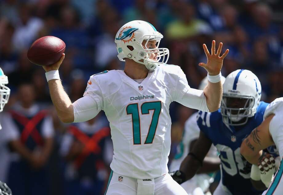 Ryan Tannehill No. 8 overall pick Miami Dolphins  With Luck, Griffin and Wilson all leading their teams to playoff appearances in their first seasons, Tannehill might be the forgotten man of the group. New Dolphins coach Joe Philbin hitched his wagon to the former Texas A&M wide receiver-turned-quarterback, and after beating out Matt Moore and David Garrad in the preseason Tannehill started all 16 games for the Phins in 2012. He put up respectable numbers, passing for 3,294 yards, 12 touchdowns and 13 interceptions, with one of the worst supporting casts – in terms of offensive skill positions – in the league.  Miami upgraded in the offseason, bringing in a big-play threat in former Pittsburgh Steelers WR Mike Wallace and a reliable veteran in former St. Louis Ram (and former WSU Cougar) Brandon Gibson, and the buzz surrounding Tannehill is that he looks much improved heading into his second season at the helm. Through two games he's looked it, throwing for 591 yards and completing more than 65 percent of his passes while leading the Dolphins to a 2-0 record, including a win over Luck and the Colts last Sunday. Photo: Andy Lyons, Getty Images