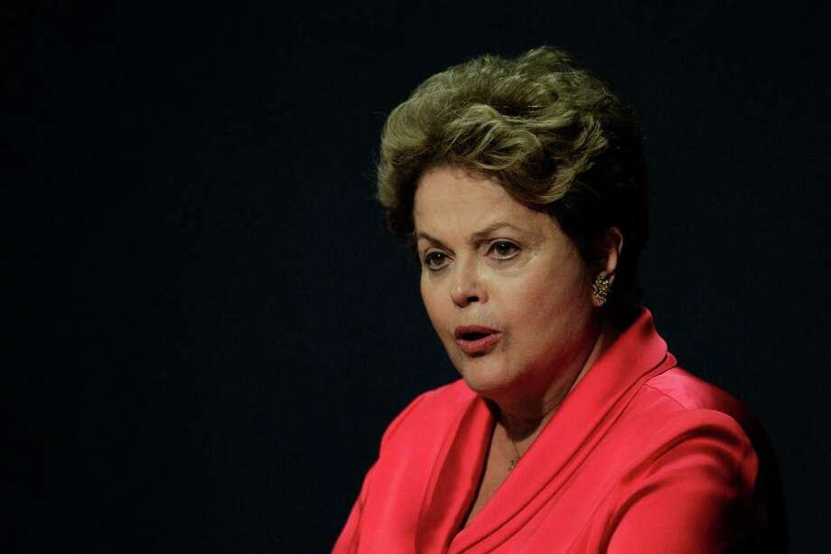 Brazil's President Dilma Rousseff speaks during a ceremony in Brasilia, Brazil, Tuesday, Sept. 17, 2013. Rousseff on Tuesday postponed a state visit to the U.S. to protest an American spy program that has aggressively targeted the Latin American nation's government and private citizens alike. Rousseff was to be honored with a state dinner next month, an event meant to highlight strengthening ties between the Western Hemisphere's two biggest nations. (AP Photo/Eraldo Peres) ORG XMIT: BSB101 Photo: Eraldo Peres / AP