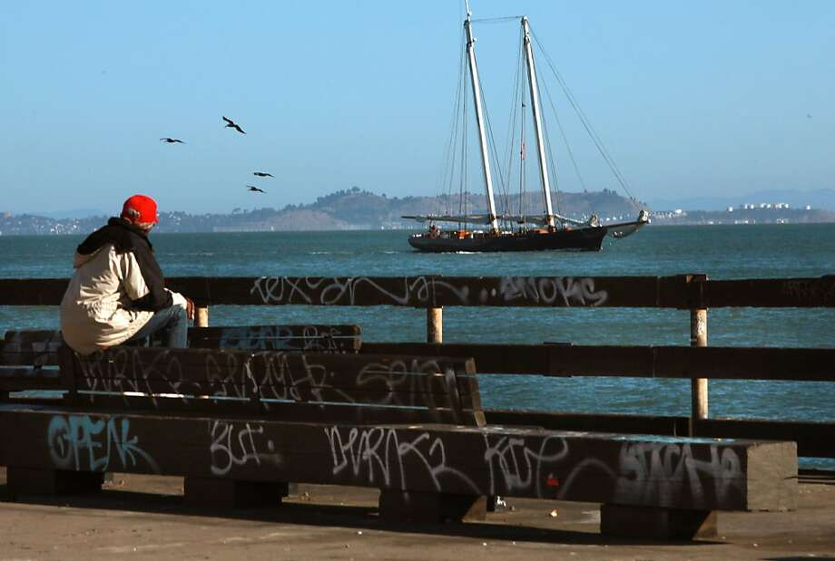 Popular benches are marred with graffiti on the dock at the Ferry Plaza, the pier behind the Ferry Building. Photo: Liz Hafalia, The Chronicle
