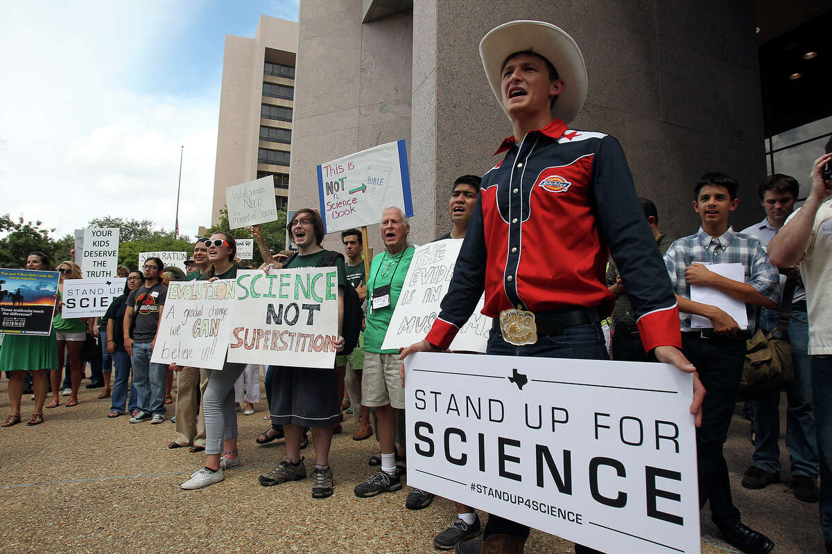 Nick Savelli wears western attire at a rally outside the William B. Travis Building in Austin as the State Board of Education conducts a public hearing regarding content in textbooks, including science textbooks, on September 17, 2013.