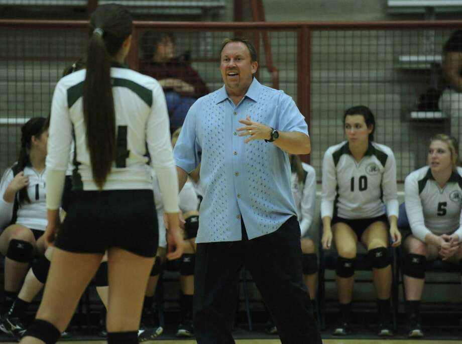 Mike Carter says he never expected to be in volleyball coaching long enough to reach milestones.