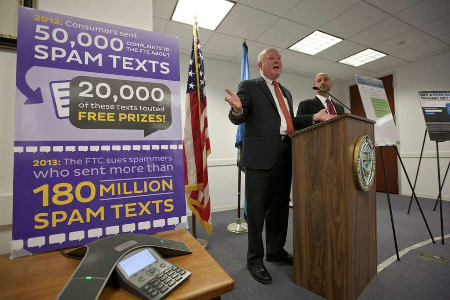 C. Steven Baker of the Federal Trade Commission tells about unwanted text messages during a Chicago news conference in March. The commission said Tuesday it settled charges against a Florida company. Photo: JOHN GRESS, STR / NYTNS