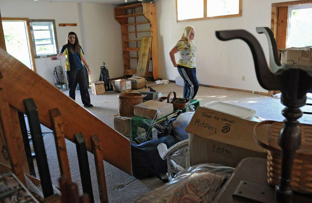 From left, Cohoes High School students Madden Umholtz, 15, and Gina Martini, 16, look for items to remove from a room that needs it's carpet replaced at Brian Holloway's Stephentown, N.Y. house on Tuesday, Sept. 17, 2013. (Lori Van Buren / Times Union)