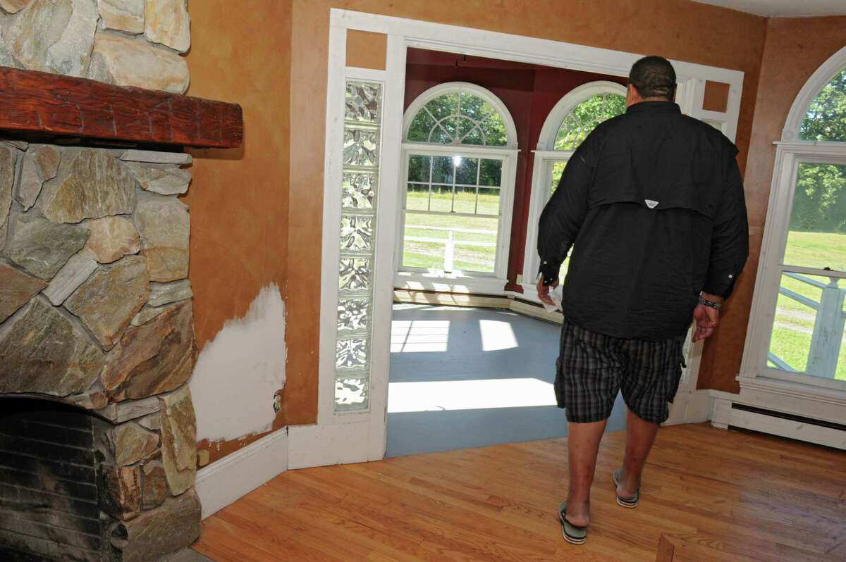 Brian Holloway shows where one of many holes were patched up in his Stephentown, N.Y. house on Tuesday, Sept. 17, 2013. Holloway, a former NFL football player, had his house trashed during a party by hundreds of teenagers. (Lori Van Buren / Times Union)