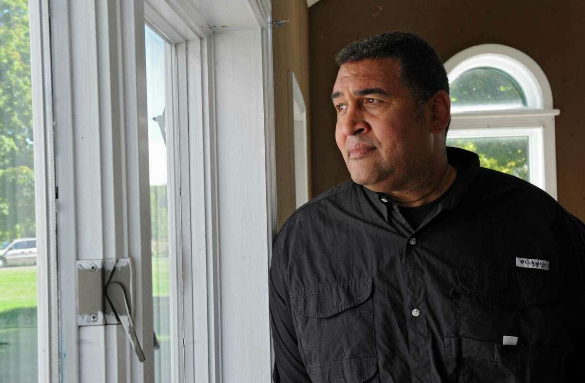 Brian Holloway looks out a window at his Stephentown, N.Y. house on Tuesday, Sept. 17, 2013. (Lori Van Buren / Times Union archive)