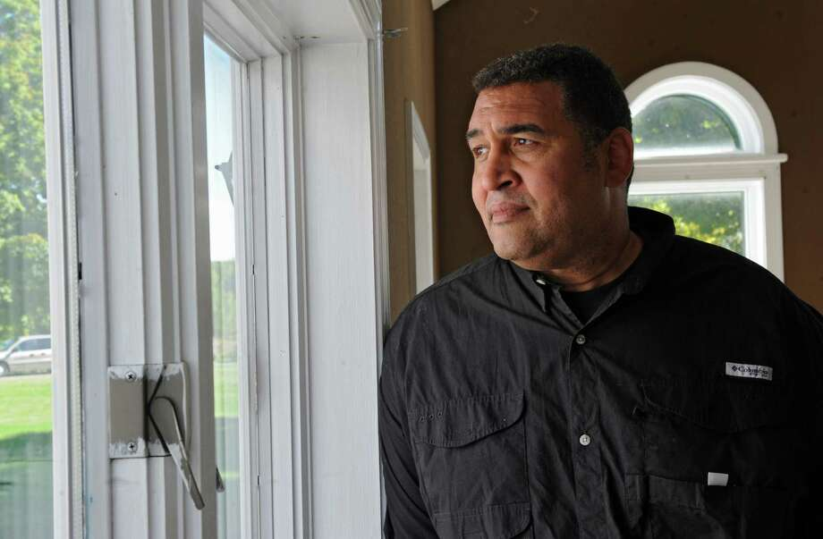 Brian Holloway looks out a window at his Stephentown, N.Y. house  on Tuesday, Sept. 17, 2013. (Lori Van Buren / Times Union archive) Photo: Lori Van Buren / 00023900A