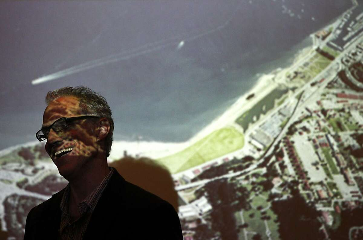 Marc L'Italien, Design Principal, EHDD, laughs as he chats with people in front of a projection of Crissy Field Center before an architectural forum featuring three finalists presenting on the new Presidio cultural institution plans September 17, 2013 at the AIA San Francisco / Center for Architecture + Design in downtown San Francisco, Calif. The presentations were part of the Architecture and the City Festival, an event being held through the end of the week featuring discussions and lectures on architecture, design and urban planning.