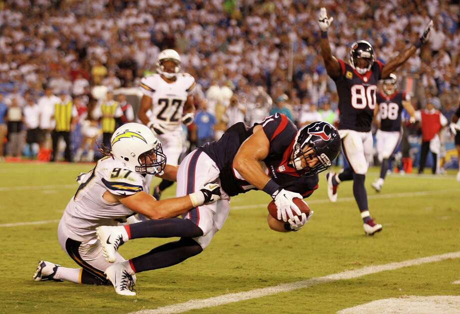Owen Daniels fights his way into the end zone against the Chargers, one of seven touchdowns in seven red-zone possessions by the Texans this season. Daniels has three of the touchdowns. Photo: Brett Coomer, Staff / © 2013  Houston Chronicle