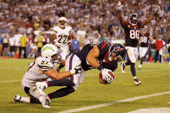 Owen Daniels fights his way into the end zone against the Chargers, one of seven touchdowns in seven red-zone possessions by the Texans this season. Daniels has three of the touchdowns.