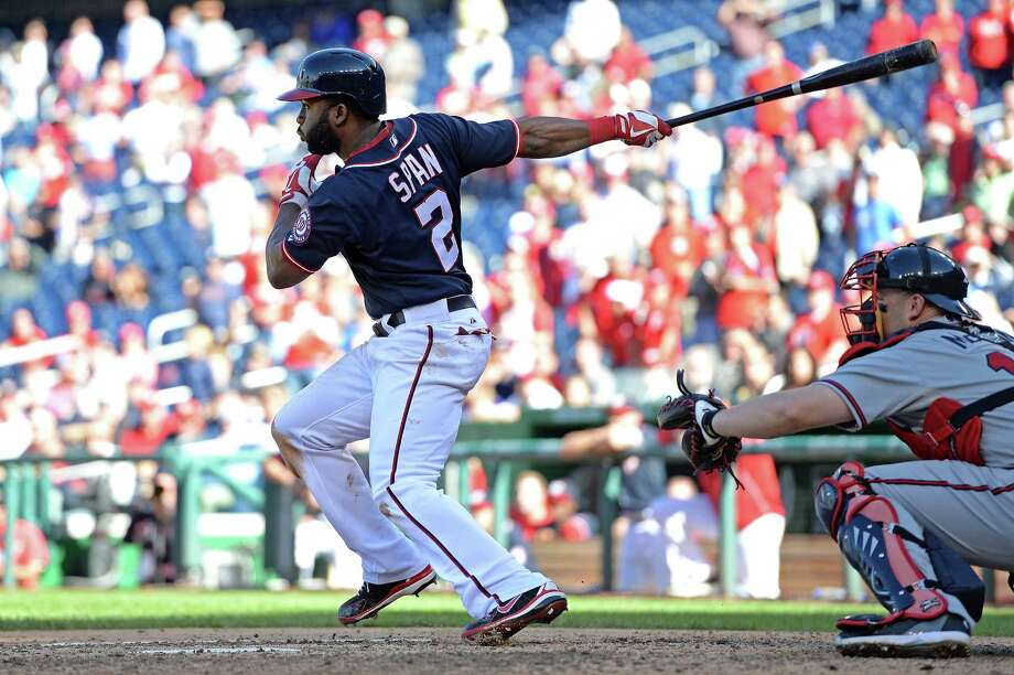 WASHINGTON, DC - SEPTEMBER 17: Denard Span #2 of the Washington Nationals hits to bring in the game-winning run against the Atlanta Braves in the ninth inning at Nationals Park on September 17, 2013 in Washington, DC. The Washington Nationals won, 6-5.(Photo by Patrick Smith/Getty Images) ORG XMIT: 181129157 Photo: Patrick Smith / 2013 Getty Images