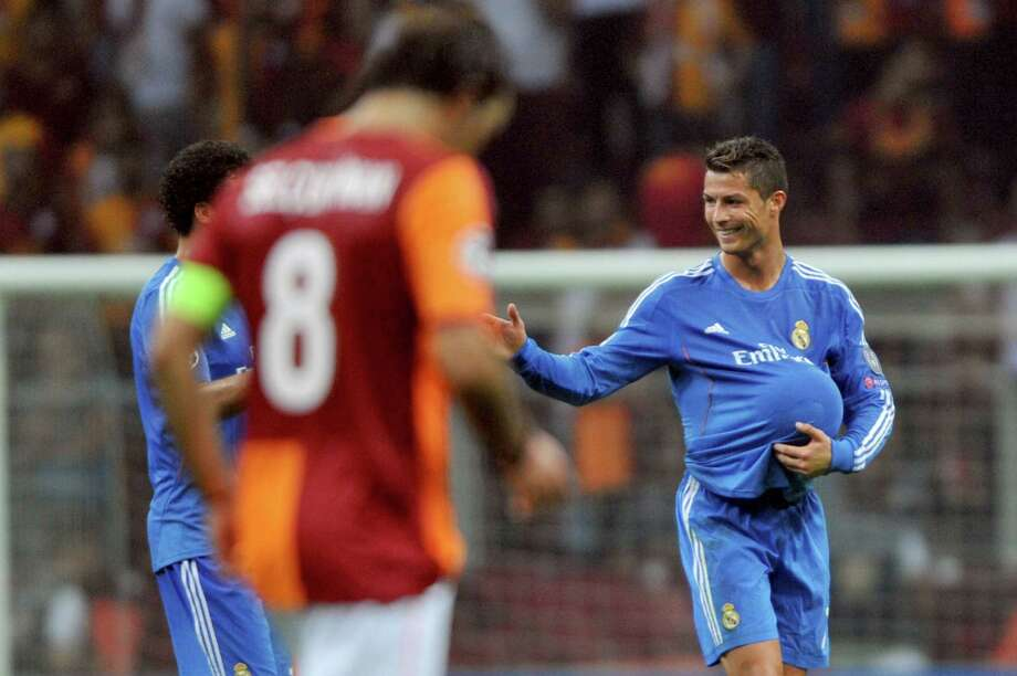 Real Madrid's Cristiano Ronaldo (R) gestures at the end of the UEFA Champions League football match Galatasaray vs Real Madrid on September 17, 2013 at the TT Arena Stadium in Istanbul. Madrid won 6 to 1.     AFP PHOTO/ OZAN KOSEOZAN KOSE/AFP/Getty Images Photo: OZAN KOSE, Stringer / AFP