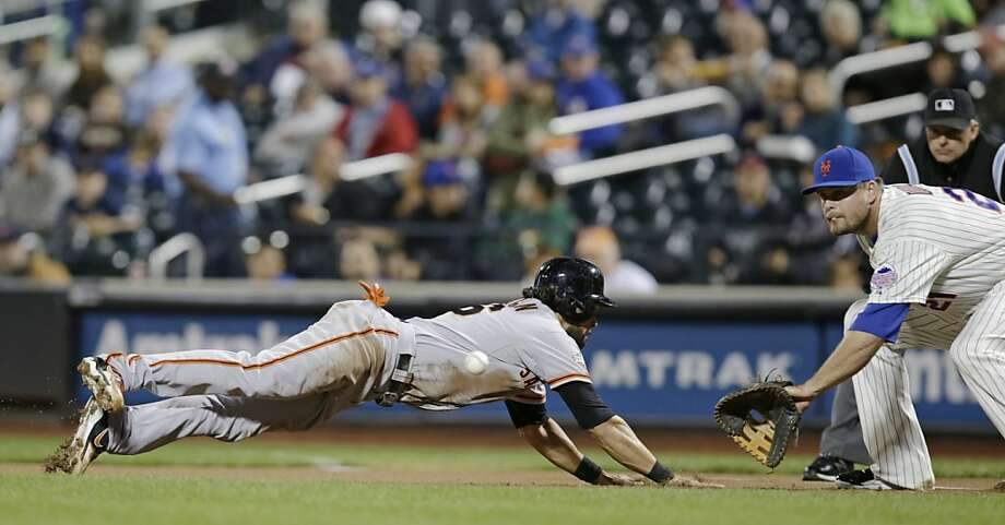 Angel Pagan, who had a homer, triple and single, beats a first-inning pickoff throw to Lucas Duda. Photo: Kathy Willens, Associated Press