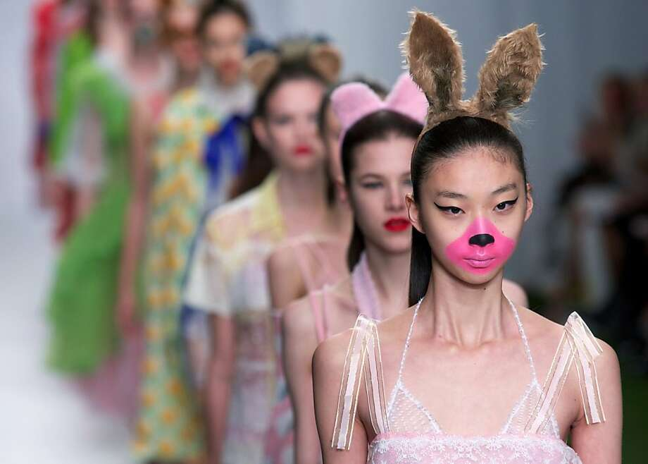 TOPSHOTS Models present creations by Fashion East designer Ryan Lo during the 2014 Spring/Summer London Fashion Week in London on September 17, 2013. AFP PHOTO / ANDREW COWIEANDREW COWIE,ANDREW COWIE/AFP/Getty Images Photo: Afp, AFP/Getty Images