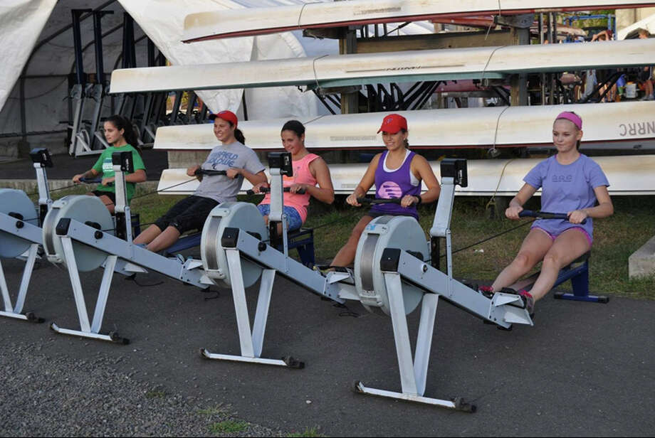 Members of Norwalk River Rowing Association's girls varsity racing team warm up for practice. From left, Manuela Artia, Caroline Lawlor, Amelia Ornato, Nicole Vacas and Lindsay Clark. The team will be participating in an Ergathon on Saturday, Sept. 21, at the Darien Sport Shop. Photo: Contributed