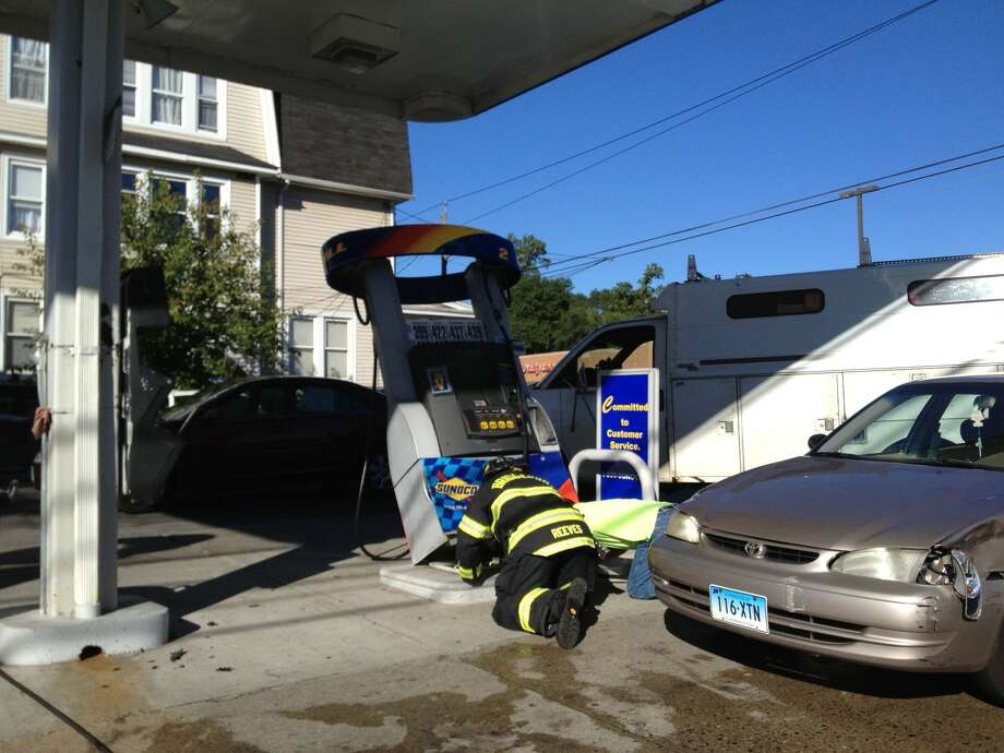 A car struck a gas pump at a Sunoco station on Main Street in Bridgeport on Wednesday, Sept. 18, 2013. Witnesses said a car hit another vehicle at the station, pushing it into the pump. Bridgeport firefighters responded to the accident. Photo: Connecticut Post
