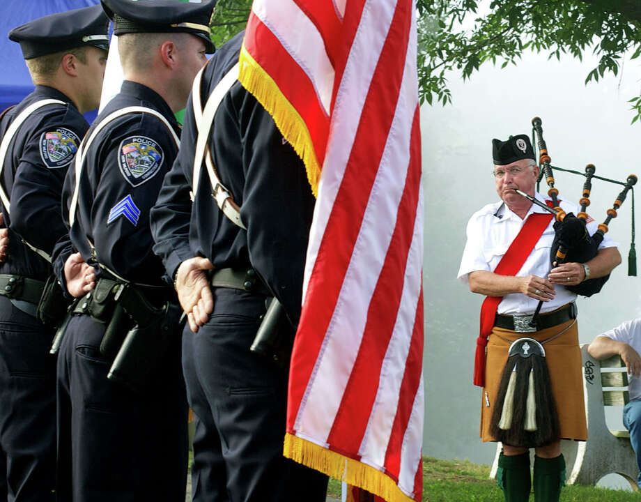 Patrick Maguire performs on bag pipes during New Milford's Sept. 11, 2013 ceremony at the Patriot's Way 9/11 memorial. Photo: Trish Haldin
