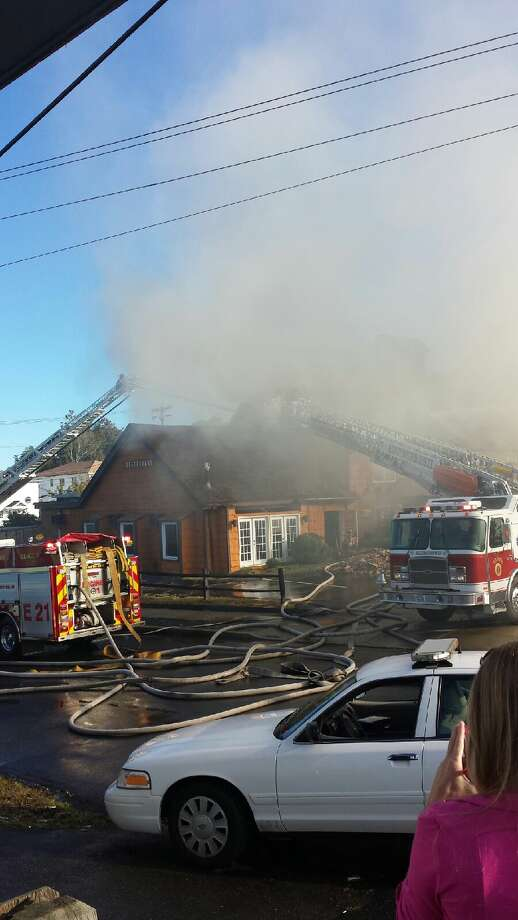 West Haven firefighters battle a fire at the former Chuck's Steakhouse on the Post Road on Wednesday, Sept. 19, 2013. The building is now the home of Geno's Steakhouse. Photo: Contributed Photo