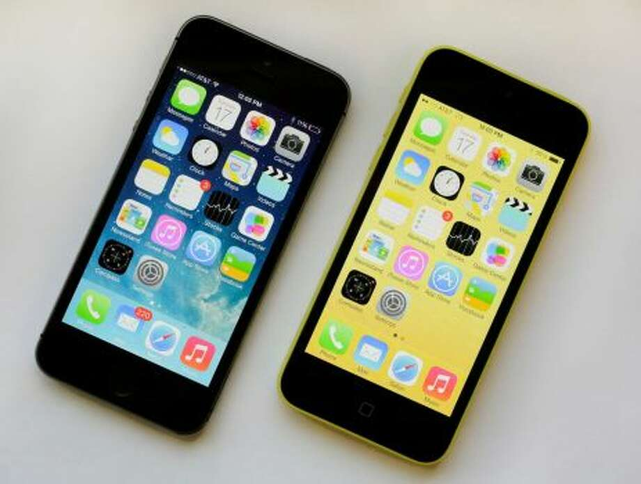 The iPhone 5S, left, and iPhone 5c are displayed Tuesday, Sept. 17, 2013, in New York. The 5S offers a fingerprint sensor, a better camera and a faster processor, while the iPhone 5C is largely last year's iPhone 5 with a plastic back and a choice of five colors. Photo: Mark Lennihan, Associated Press