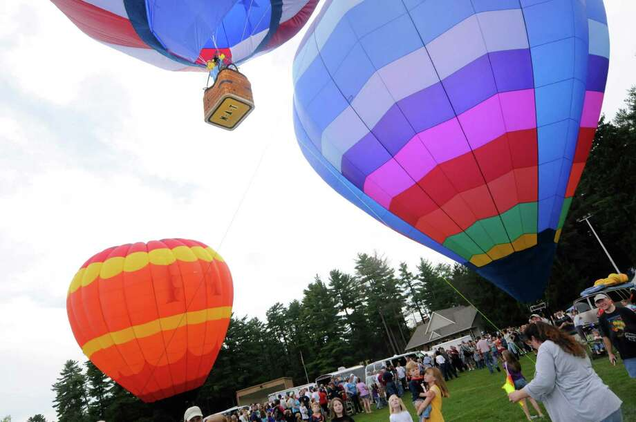 Experience the color and excitement as hundreds of hot air balloons take to the sky at the 42nd Annual Adirondack Balloon Festival. When: Friday, 3:00 p.m., Saturday -  Sunday, 6:30 a.m. Where: Floyd Bennett Memorial Airport, Queensbury and Crandall Park, Glens Falls. Learn more. Photo: Michael P. Farrell / 00014721A