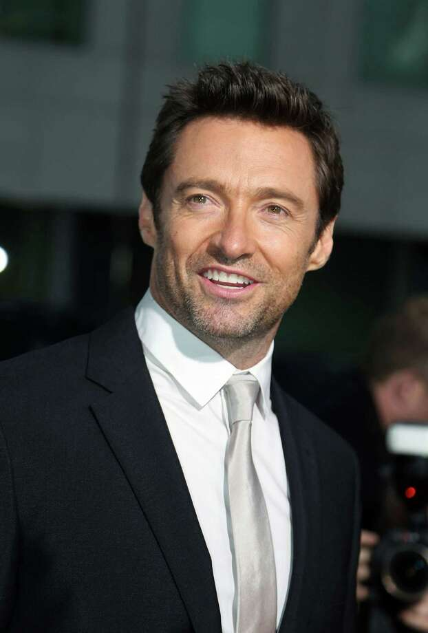 "Hugh Jackman arrives at the premiere of ""Prisoners"" at The Academy of Motion Picture Arts and Sciences on Thursday, Sept. 12, 2013 in Beverly Hills, Calif. (Photo by Jose Flores/Invision/AP) ORG XMIT: CAJF103 Photo: Jose Flores / Invision"