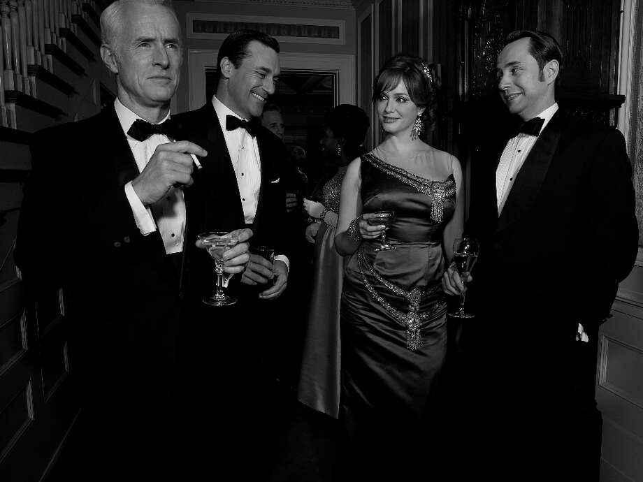 Roger Sterling (John Slattery), Don Draper (Jon Hamm), Joan Harris (Christina Hendricks) and Pete Campbell (Vincent Kartheiser) - Mad Men - Season 6 - Teaser Gallery - Photo Credit: Frank Ockenfels/AMC Photo: Frank Ockenfels/AMC