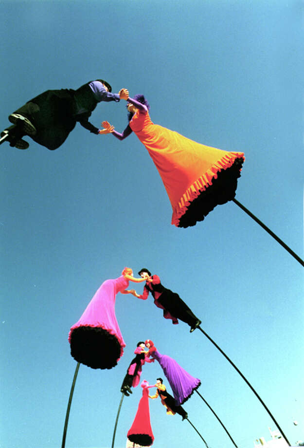 Members of Australia's Strange Fruit troupe balance on 14-foot-tall poles as part of the group's dance, theater and circus act. Photo: Henry Krul