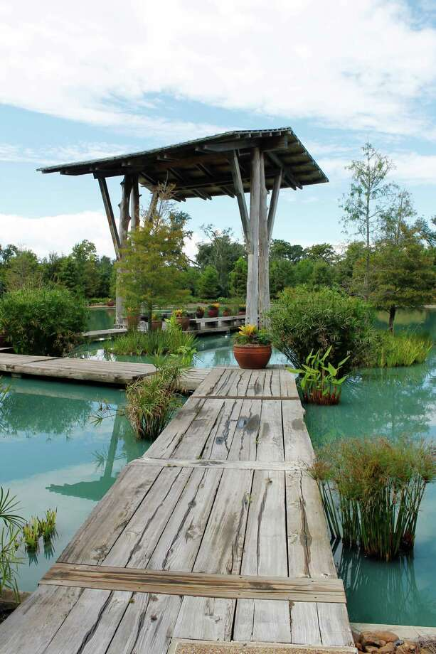 The Cypress Gate at the Pond of the Blue Moon is an inviting oasis at the Shangri La Botanical Gardens and Nature Center in Orange. Photo: Betty Luman, Staff / © 2012  Houston Chronicle