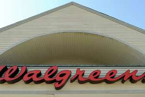 FILE - The sign above a Walgreens entrance, is seen in this Monday, Sept. 28, 2009 file photo taken in Gloucester, Mass. Walgreen Co. will become the latest big employer to send its workers shopping for their health insurance coverage instead of providing a few plan choices for them. The nation's largest drugstore chain said Wednesday Sept. 18, 2013 that it will start giving workers a contribution toward the cost of coverage and then send them to a private health insurance exchange where they will pick from as many as 25 plans. Walgreen currently offers its workers two to four options depending on where the employee lives. (AP Photo/Lisa Poole, File) ORG XMIT: NY114