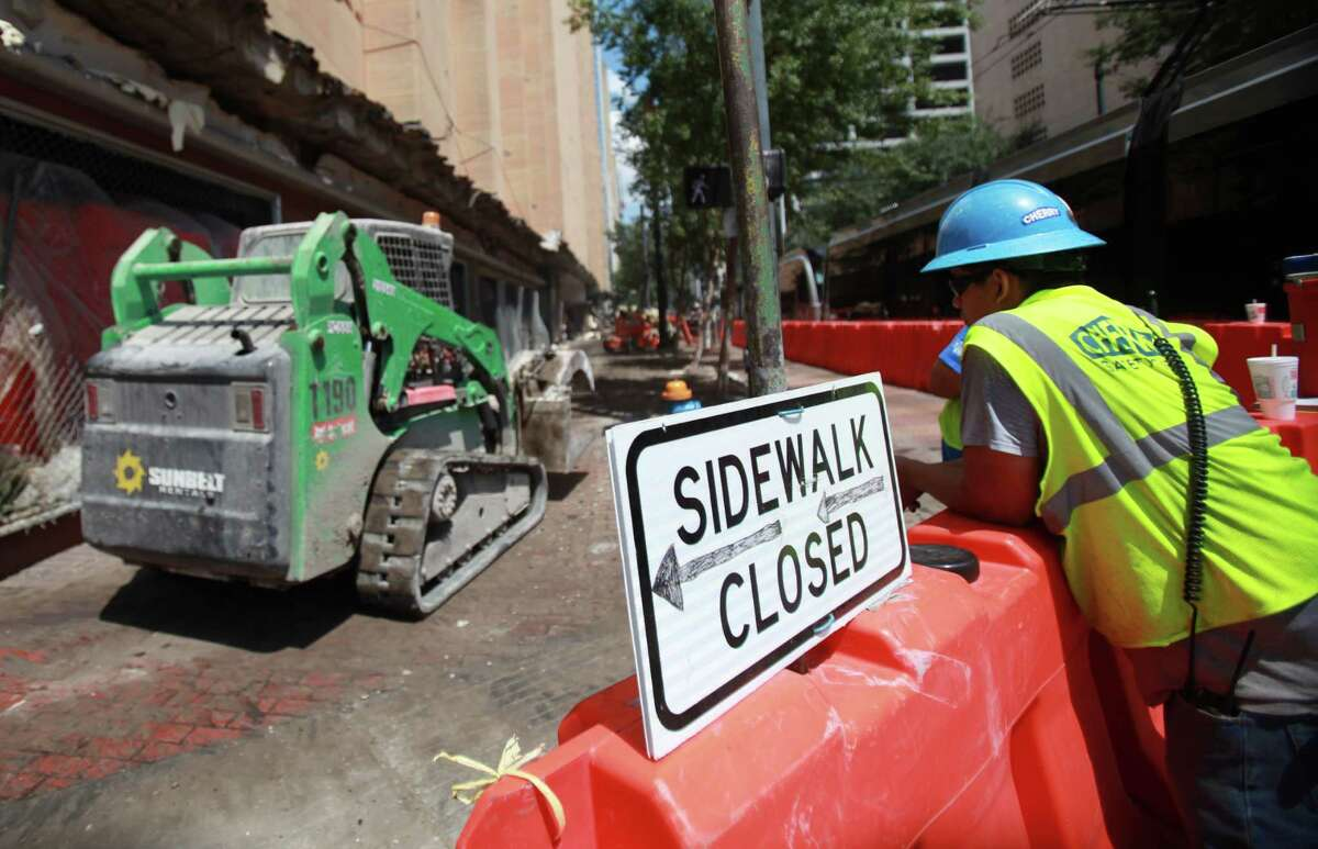 The entire former Macy's block is closed to pedestrians as crews prepare building for the implosion next week on Thursday, Sept. 12, 2013, in Houston. ( Mayra Beltran / Houston Chronicle )