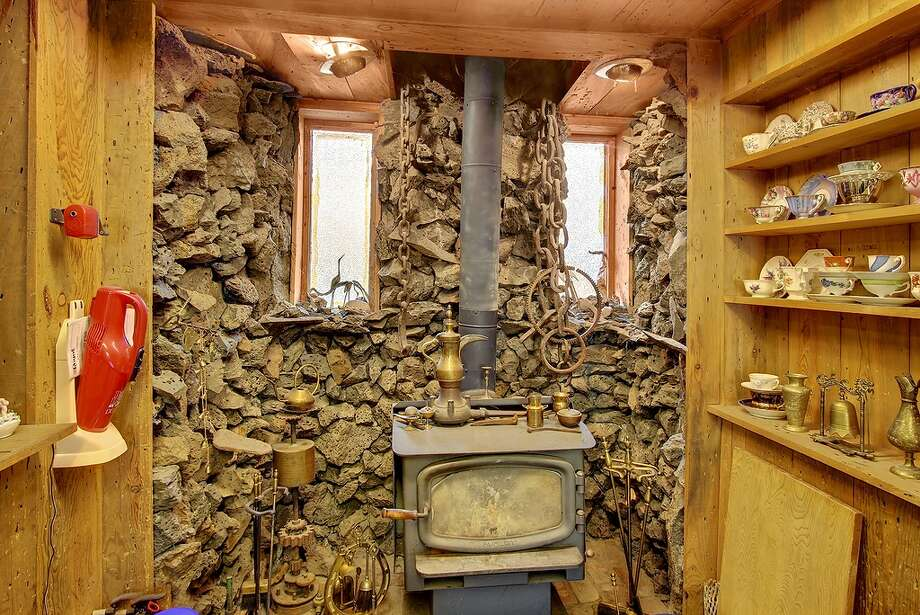 Then there's this lava-rock wall around a wood stove of 2216 N.W. 63rd St. We think the chains are just decoration. Photo: Redfin