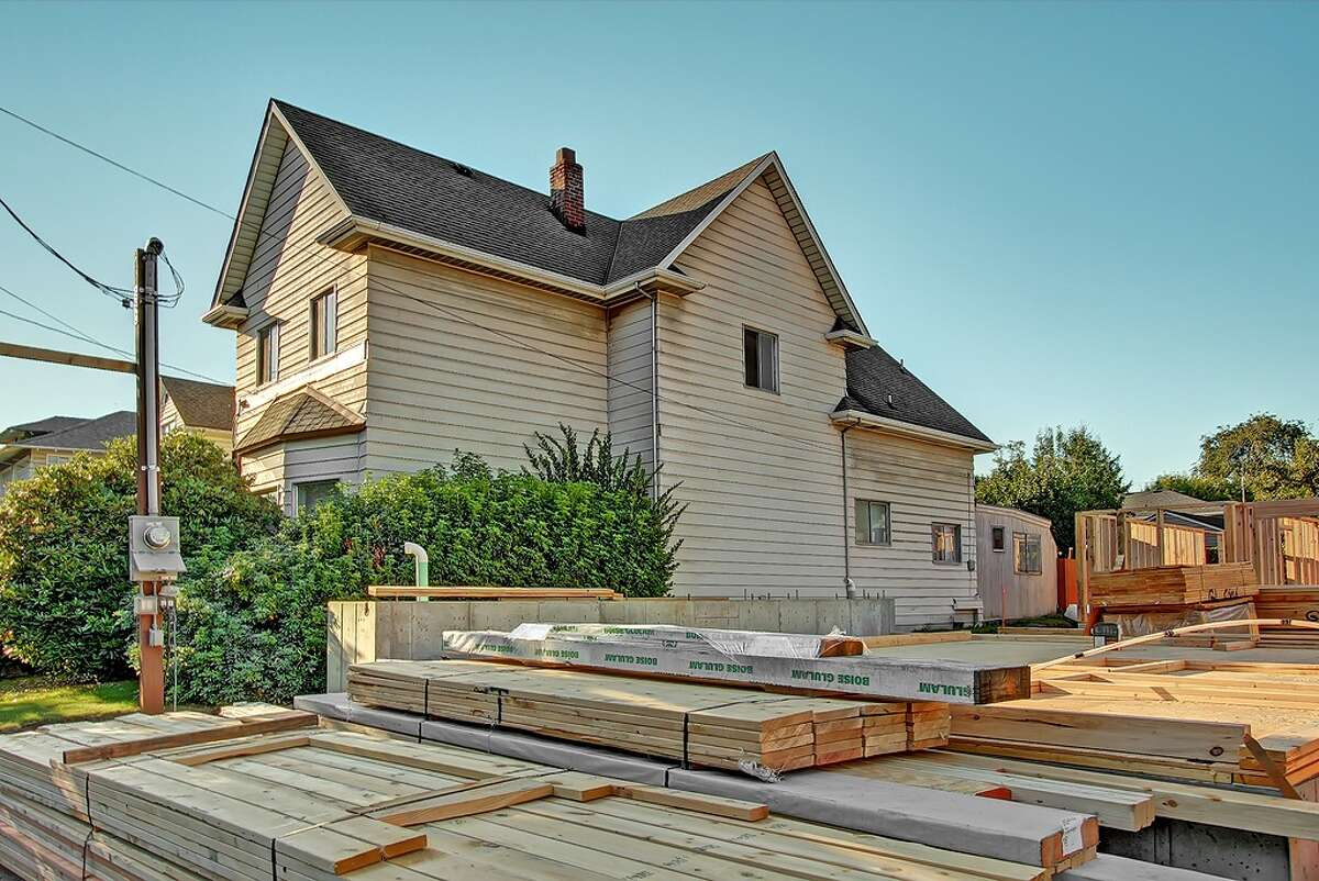 The 1,950-square-foot house has four bedrooms and one bathroom on a 5,000-square-foot lot. It's listed for $424,950. Townhouses are going in next door.