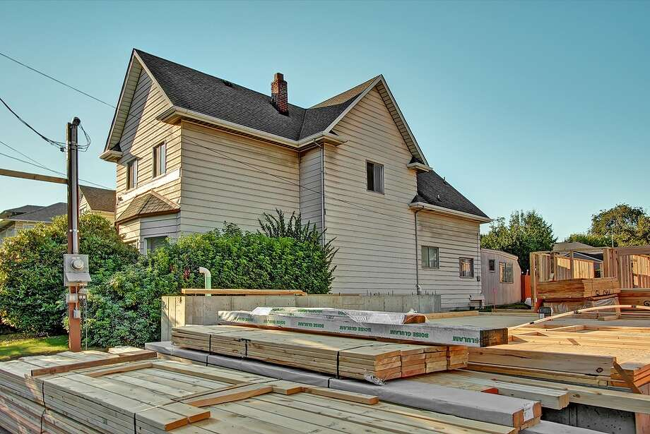 The 1,950-square-foot house has four bedrooms and one bathroom on a 5,000-square-foot lot. It's listed for $424,950. Townhouses are going in next door. Photo: Redfin