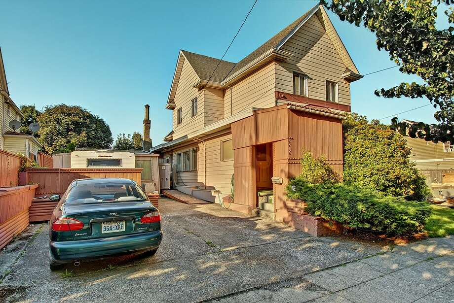 """When this listing boasts """"Artistic owner added distinctive touches,"""" it's not kidding. The house, 2216 N.W. 63rd St., has been through a few changes since was built in 1902, including the unique wooden vestibule around the front door. Click on for more. Photo: Redfin"""