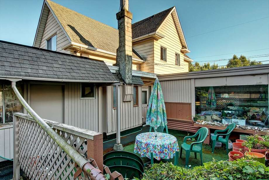 The yard of 2216 N.W. 63rd St. has lots of space for new art projects. Photo: Redfin