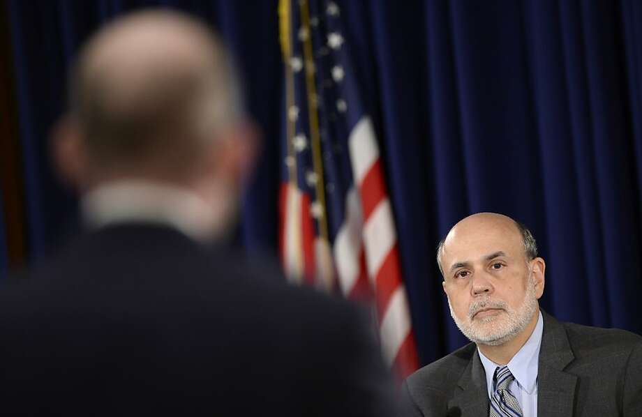 Fed Chairman Ben Bernanke discusses the bond-buying program that will continue. Photo: Susan Walsh, Associated Press