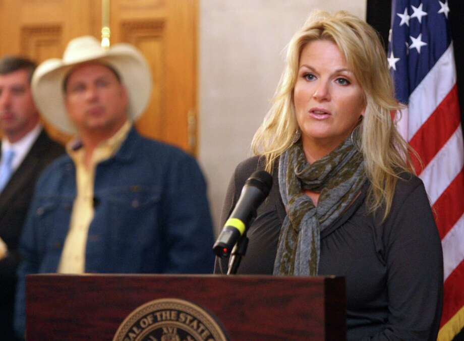 Country Music stars Trisha Yearwood, right, and Garth Brooks, left, announce they will hold a benefit concert in December 2010 for Nashville flood relief, Thursday, Oct. 28, 2010 at the old state capital in Nashville.  (AP Photo/The Tennessean, Shelley Mays) Photo: Shelley Mays / The Tennessean