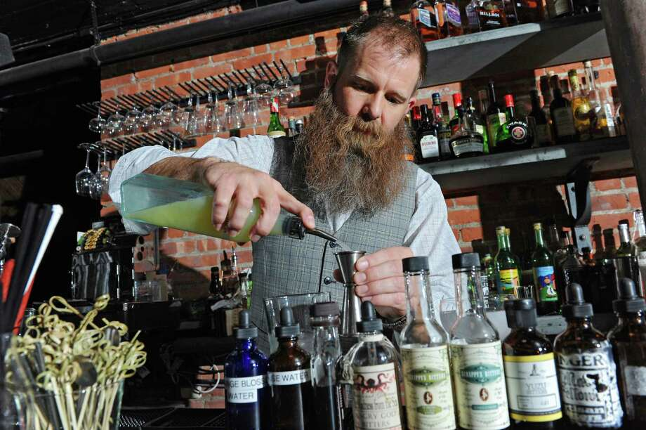 Bartender Robert Mack makes an original Jack Rose cocktail that he serves at The Speakeasy Thursday, Sept. 12, 2013 in Albany, N.Y. The Speakeasy is in basement of City Beer Hall on Howard and Lodge Streets. (Lori Van Buren / Times Union) Photo: Lori Van Buren / 00023831A