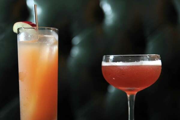 The simplified home version of the Jack Rose cocktail, on left, and the original version that's made at The Speakeasy Thursday, Sept. 12, 2013 in Albany, N.Y. The Speakeasy is in basement of City Beer Hall on Howard and Lodge Streets. (Lori Van Buren / Times Union)