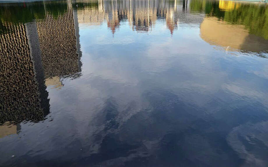 """Anita DeCianni-Brown of Green Island was at the Empire State Plaza on a Saturday evening taking photos of the plaza.  As she took photos of the Egg, she noticed the reflection of the plaza in the reflecting pool. """"It reminded me of a Monet painting,"""" she said. (Anita DeCianni-Brown)"""