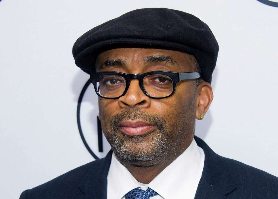 """FILE - In this June 10, 2013 file photo, Spike Lee attends the eighth annual Made in New York Awards in New York. Lee will receive the 20th annual Dorothy and Lillian Gish Prize, which carries a reward of $300,000. The Gish Prize Trust announced the selection Wednesday, Sept. 18. Selection committee chairman Darren Walker said Lee was chosen """"for his brilliance and unwavering courage in using film to challenge conventional thinking."""" (Photo by Charles Sykes/Invision/AP, File) ORG XMIT: NYET325 Photo: Charles Sykes / Invision"""